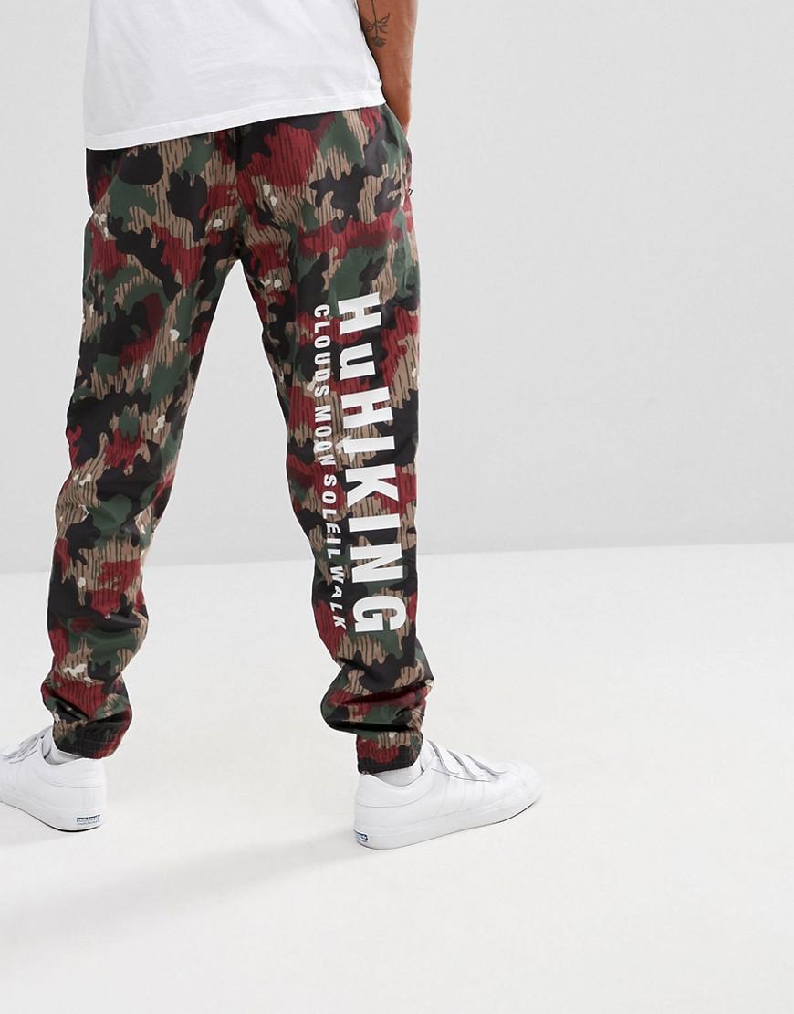 3555f3f1c292 Lyst - adidas Originals X Pharrell Williams Hu Hiking Joggers In Red ...