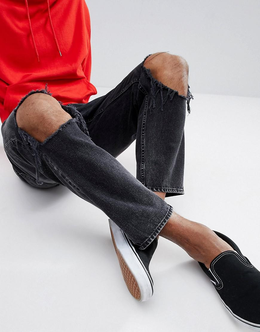 c46974ff3fd Cheap Monday In Law Tapered Jeans With Blown Out Knee in Black for ...