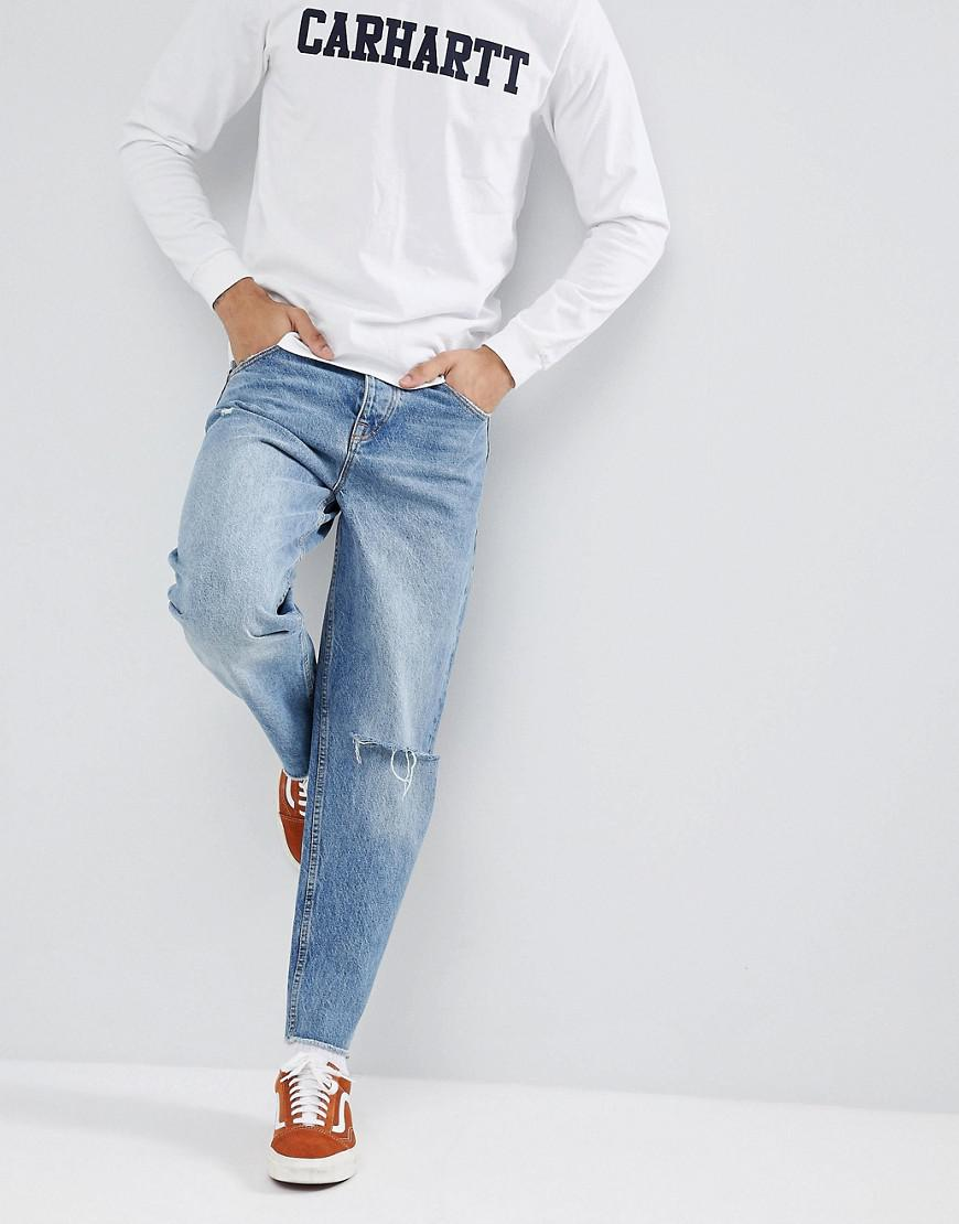 f27b12ac4821 Lyst - ASOS Skater Jeans In Mid Wash Blue With Rips in Blue for Men