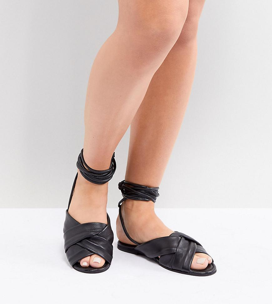 ad1fff3285e ASOS. Women s Black Wide Fit Valley Leather Knotted Tie Leg Flat Sandals