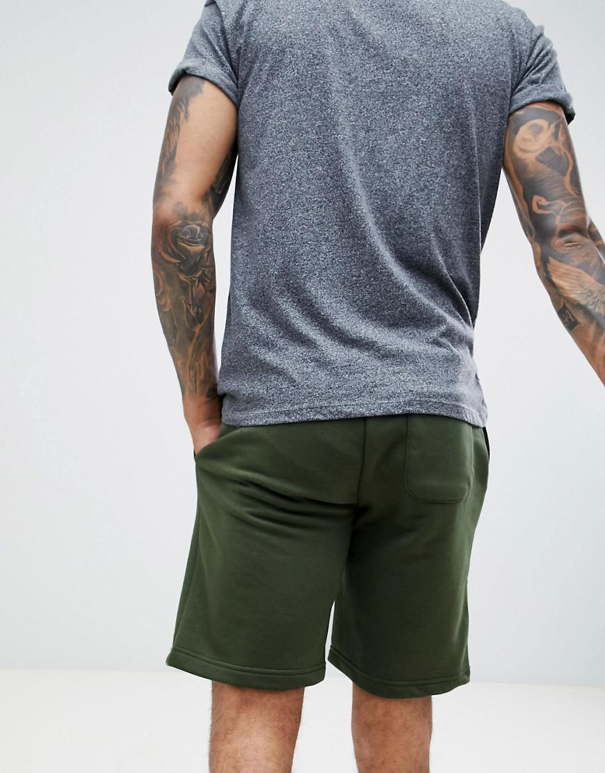 158f7d21fb10 Converse Logo Jersey Shorts In Green 10009143-a01 in Green for Men - Lyst