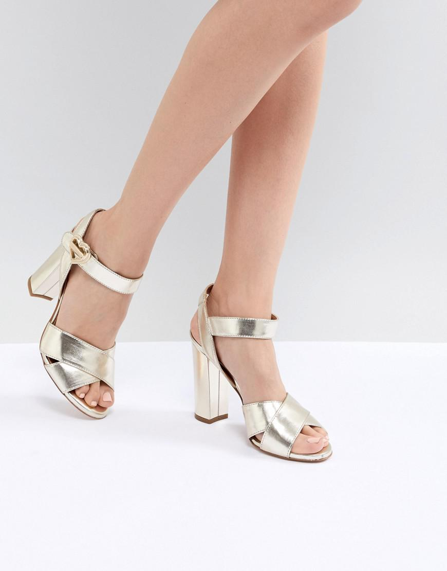 77f3a36bd26c Love Moschino Heart Buckle Heeled Sandal in Metallic - Lyst