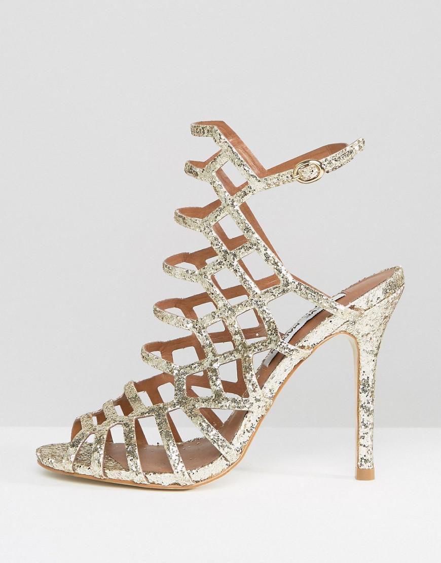 85f8290bfe7 Lyst - Steve Madden Slithur Gold Glitter Caged Heeled Sandals in ...