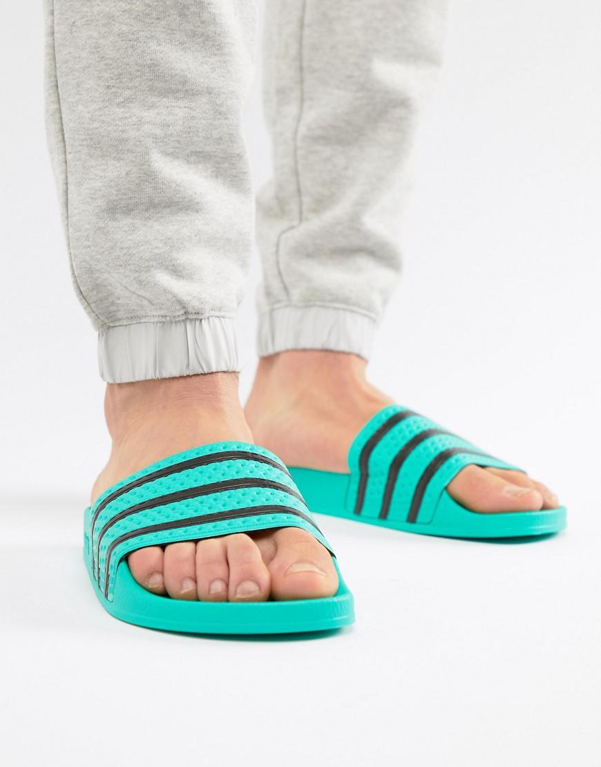 8c826dbddcc33 Lyst - adidas Originals Adilette Slides in Green for Men - Save 27%