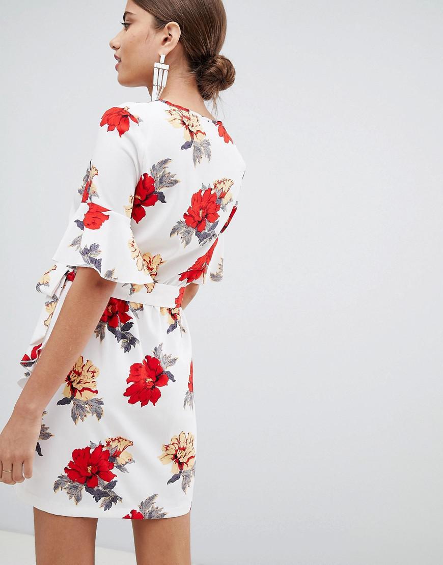 da603385081 Lyst - PrettyLittleThing Floral Tie Side Mini Dress in White