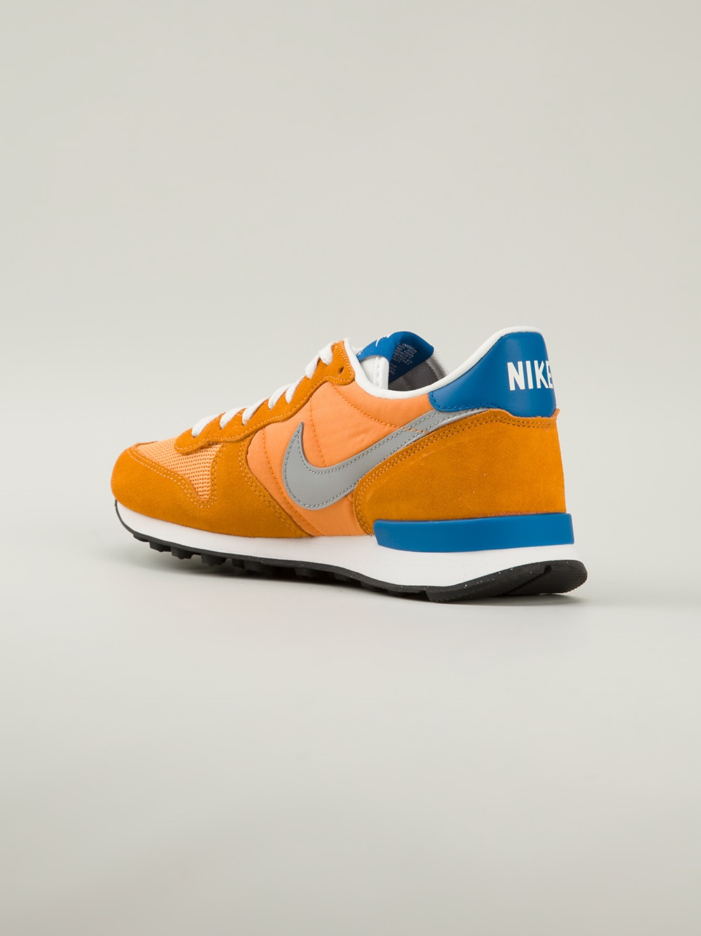 womens nike internationalist gold yellow