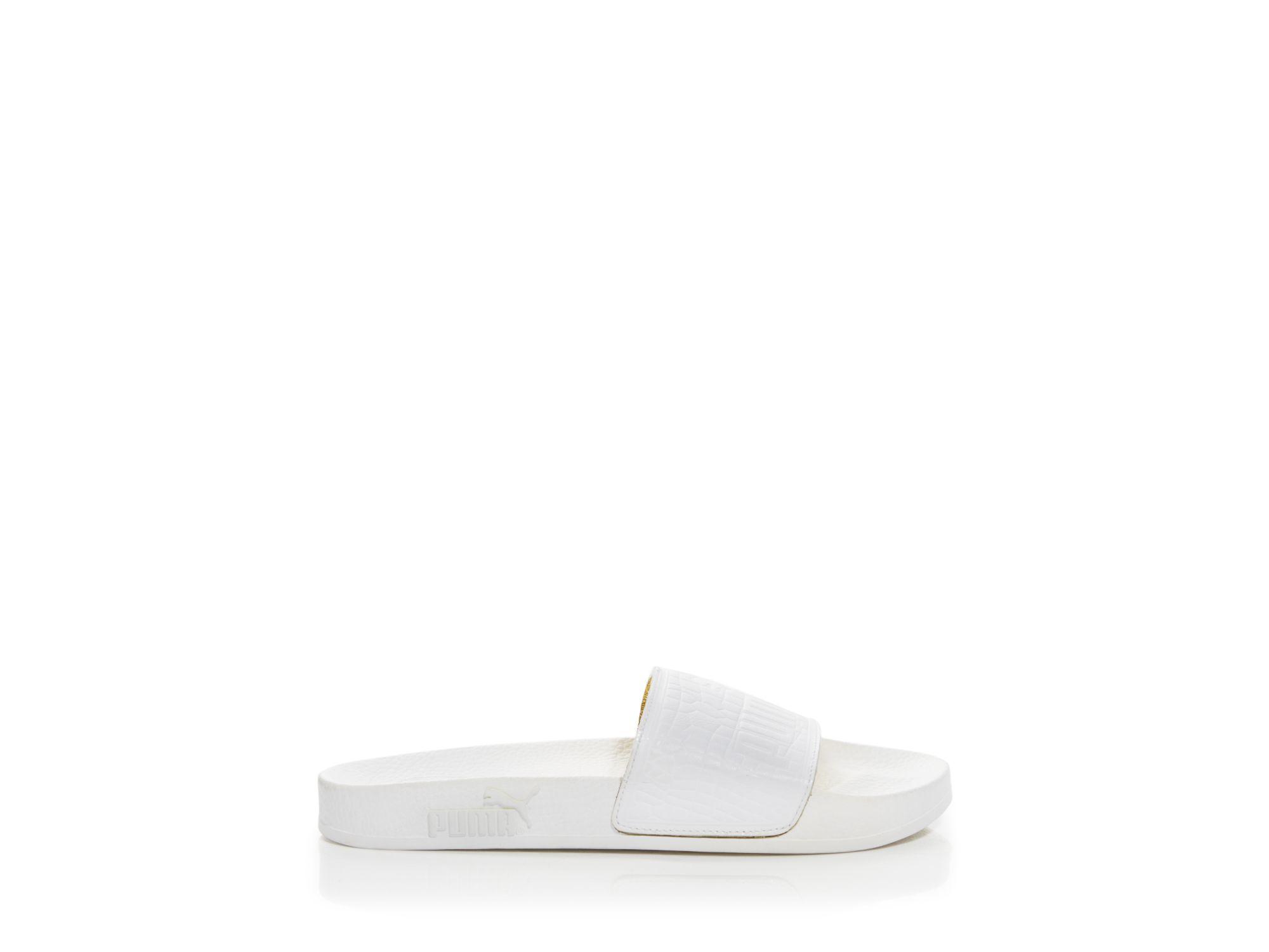 9ae7e4c676128 Lyst - PUMA Triple Black Silder Flat Sandals in Black