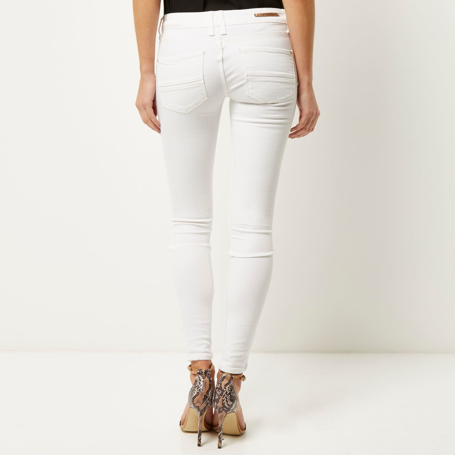 f71f41f1 River Island White Low Rise Amelie Superskinny Jeans in Orange - Lyst