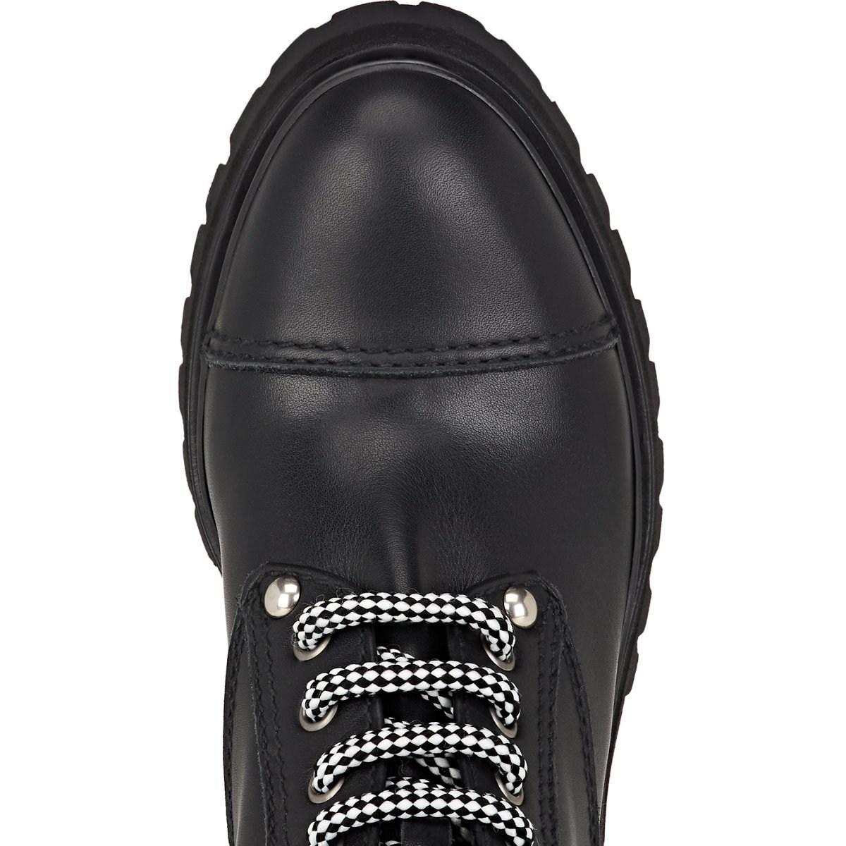 9260b2a04b168 Miu Miu - Black Lug-sole Leather Ankle Boots - Lyst. View fullscreen