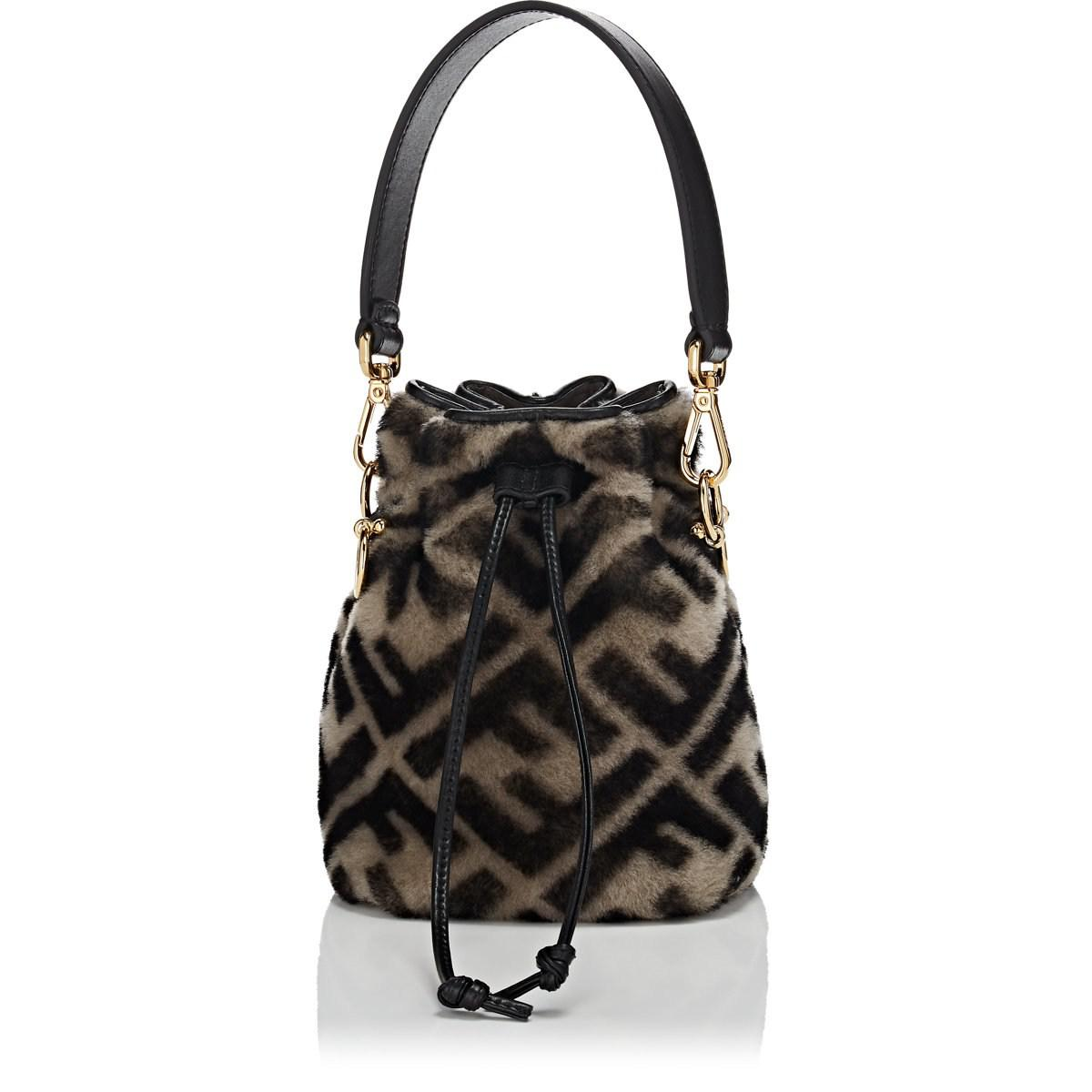 c08e3be36125 Lyst - Fendi Mon Tresor Logo Print Shearling Bucket Bag in Black