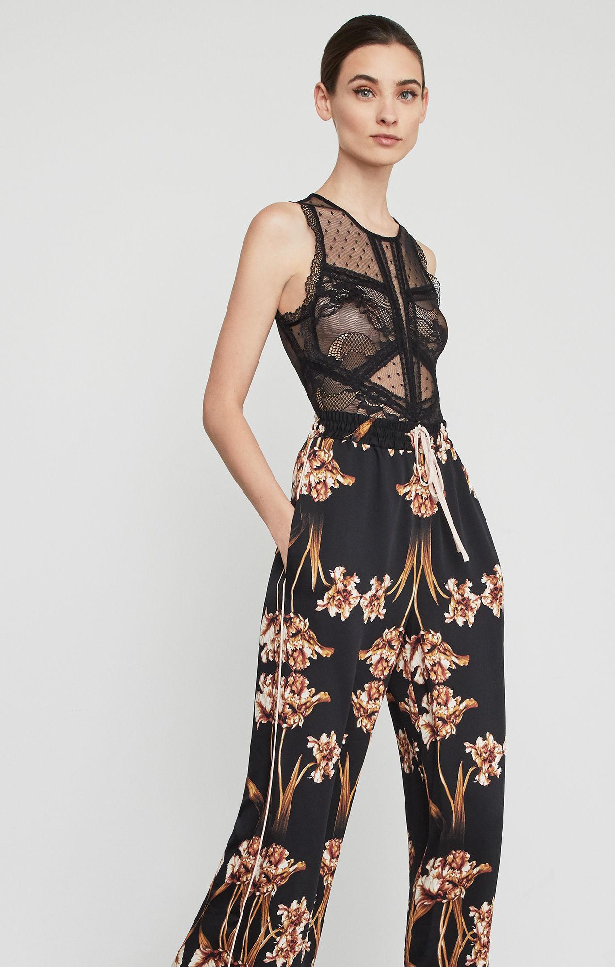 ac8e37962218 Lyst - BCBGMAXAZRIA Bcbg Sleeveless Floral Lace Bodysuit in Black