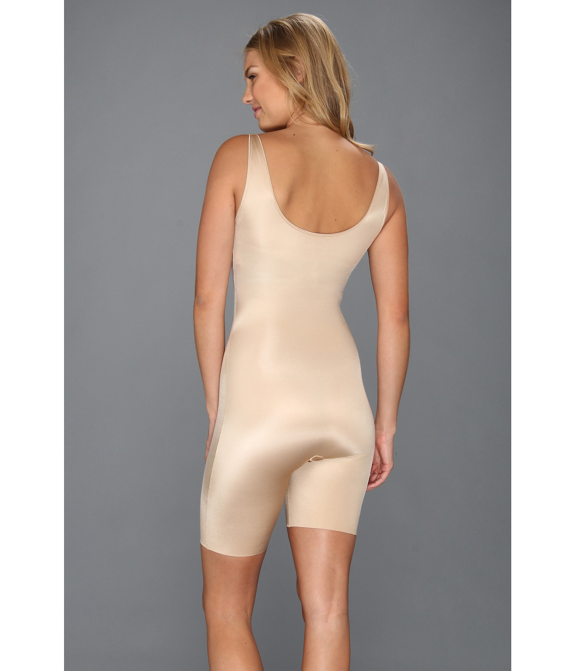 6e948430989 Lyst - Spanx Slimplicity® Open-bust Mid-thigh Bodysuit in Natural