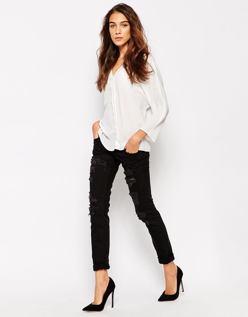 vero moda slim fit destroyed rip jeans in black lyst. Black Bedroom Furniture Sets. Home Design Ideas
