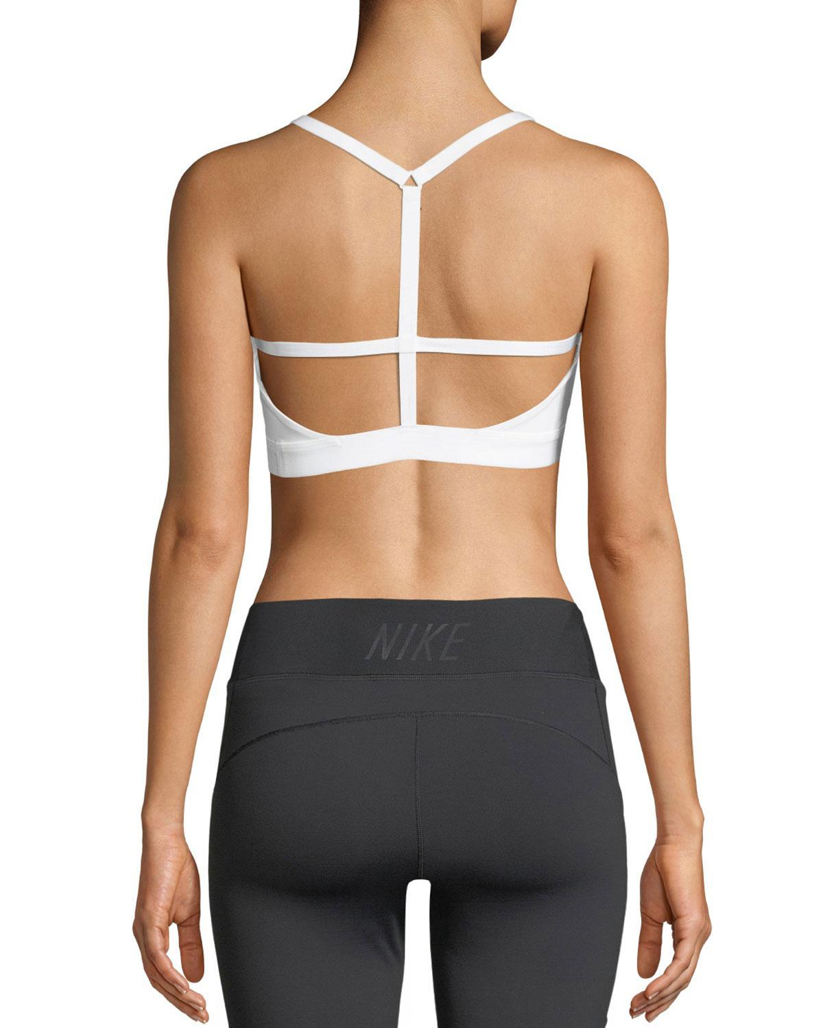 3d78bc6ea2460 Lyst - Nike Indy Light-support Strappy Sports Bra in Black