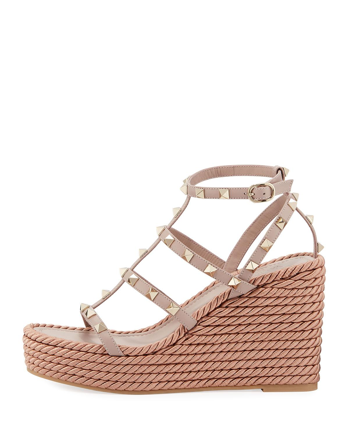 1b97fbd02db Lyst - Valentino Rockstud Caged Wedge Sandals in Natural