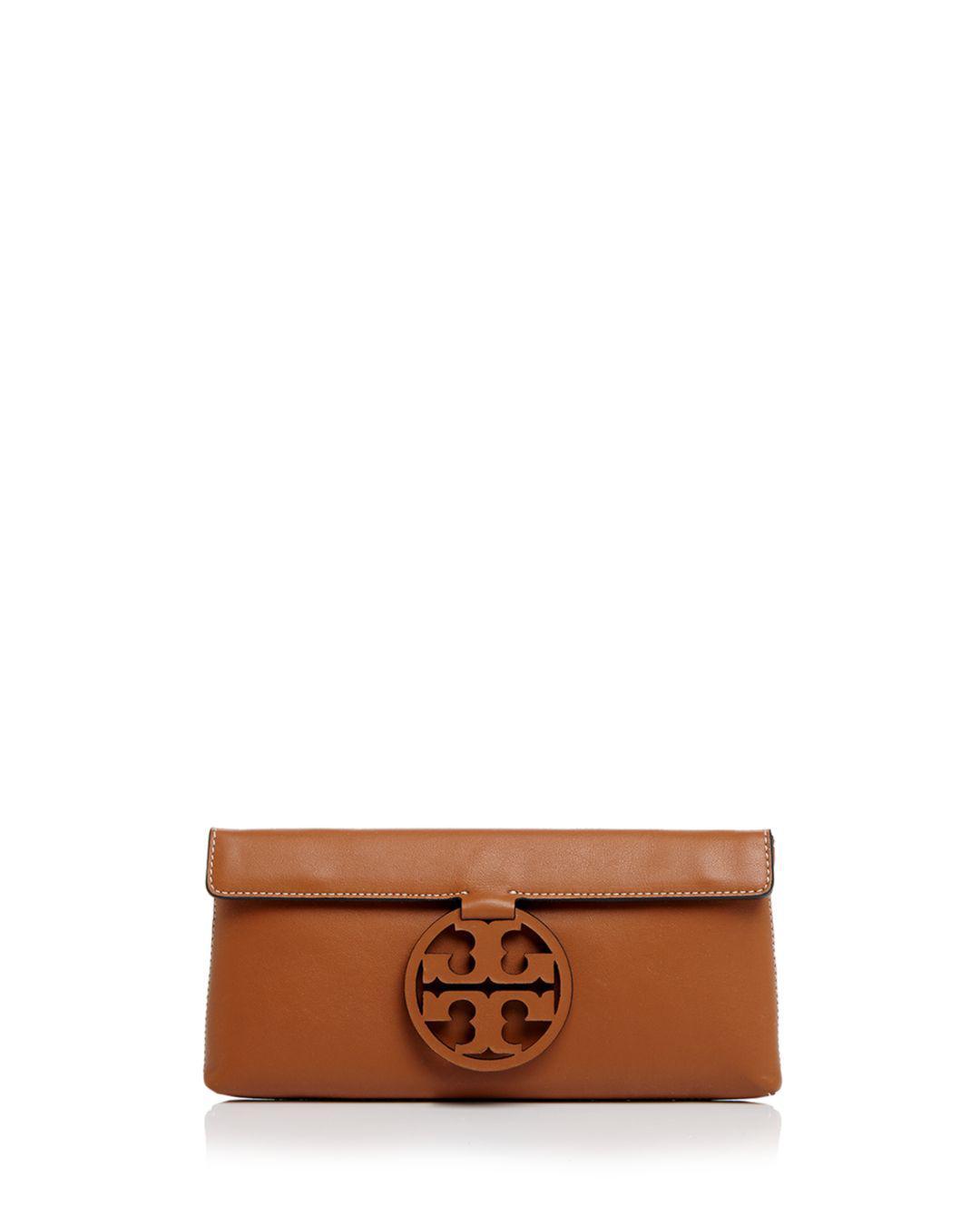 b2c2fede6988 Lyst - Tory Burch Miller Leather Clutch in Brown