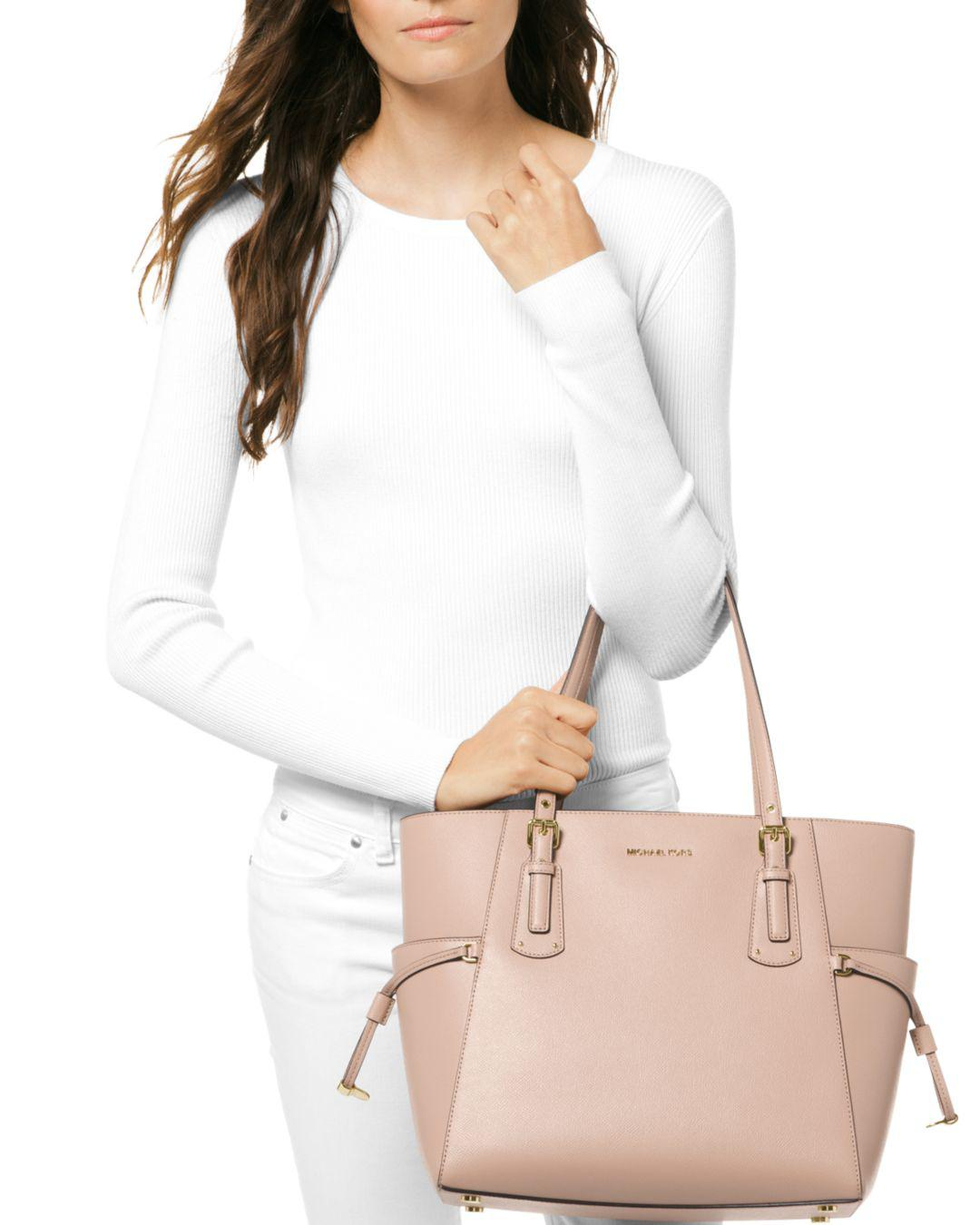 14b579b1cf99 MICHAEL Michael Kors Voyager East West Leather Tote in Pink - Save 50% -  Lyst