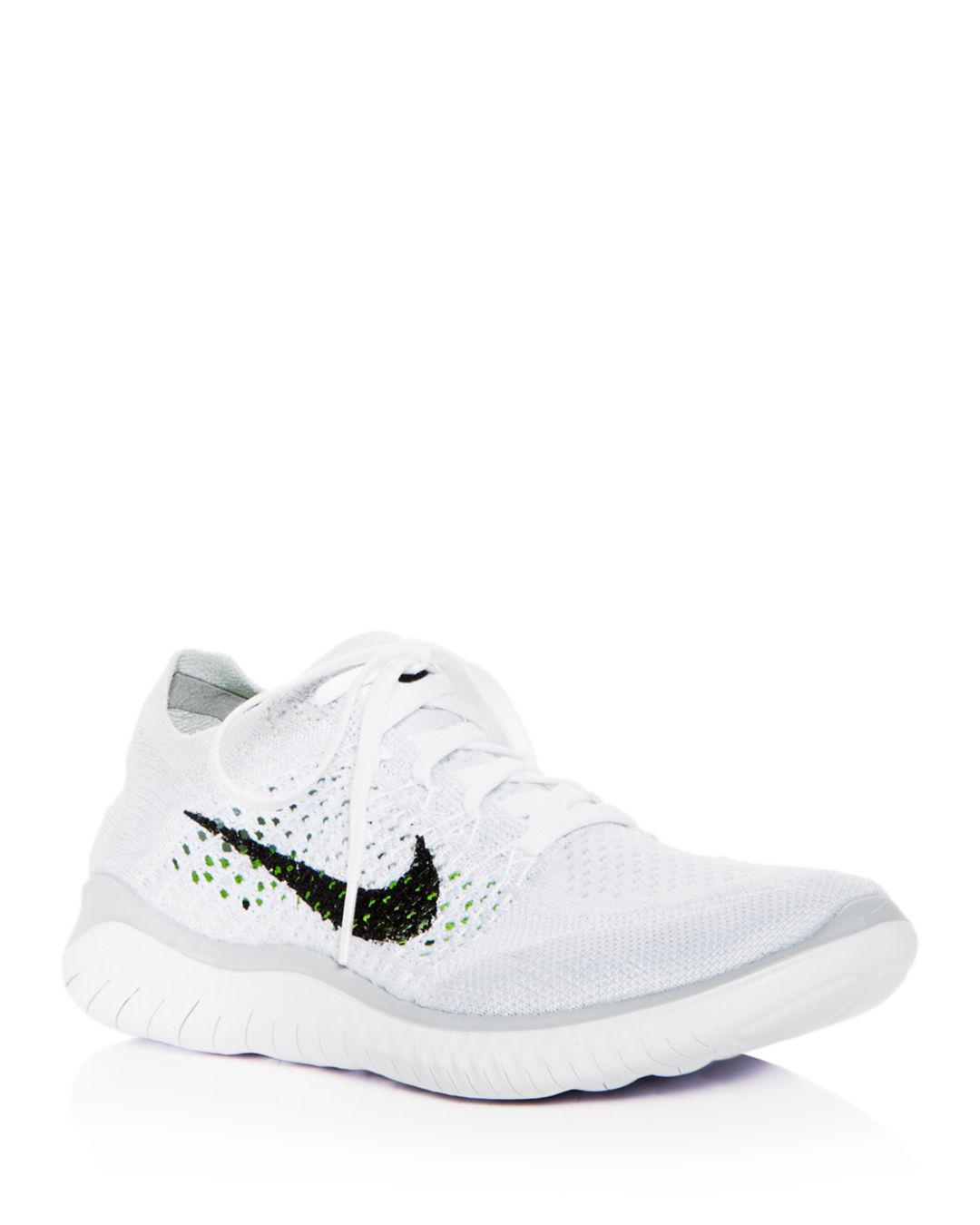 edab206565816 Lyst - Nike Women s Free Rn Flyknit 2018 Lace Up Sneakers in White ...