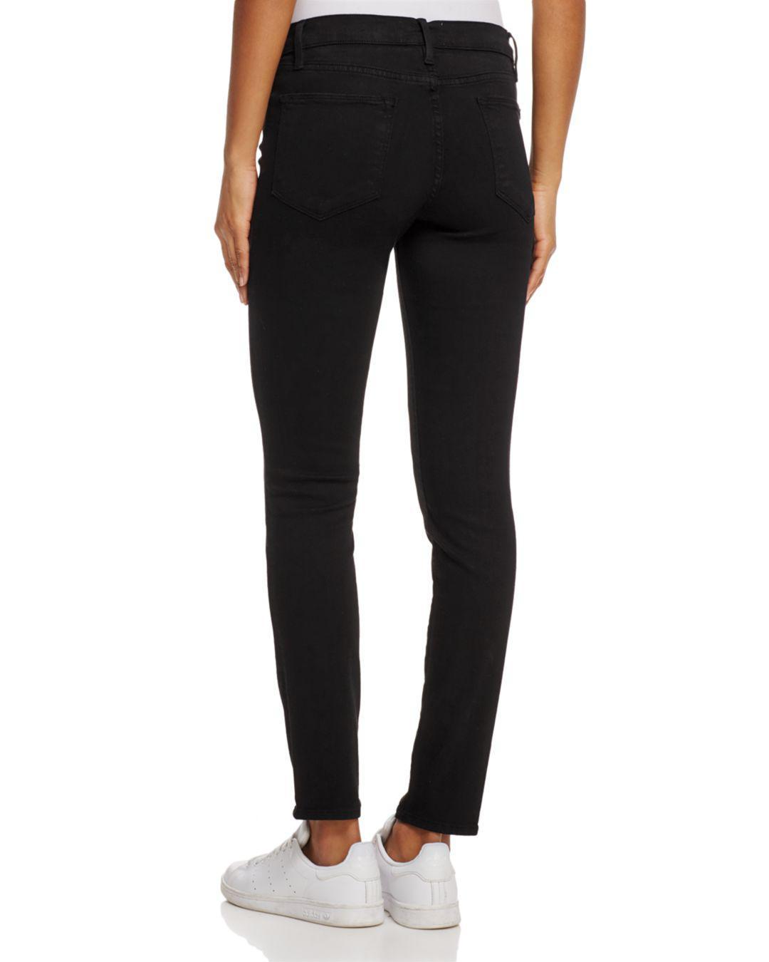0fa74b0ae8e Lyst - FRAME Le High Skinny Split-hem Jeans In Film Noir in Black - Save 9%