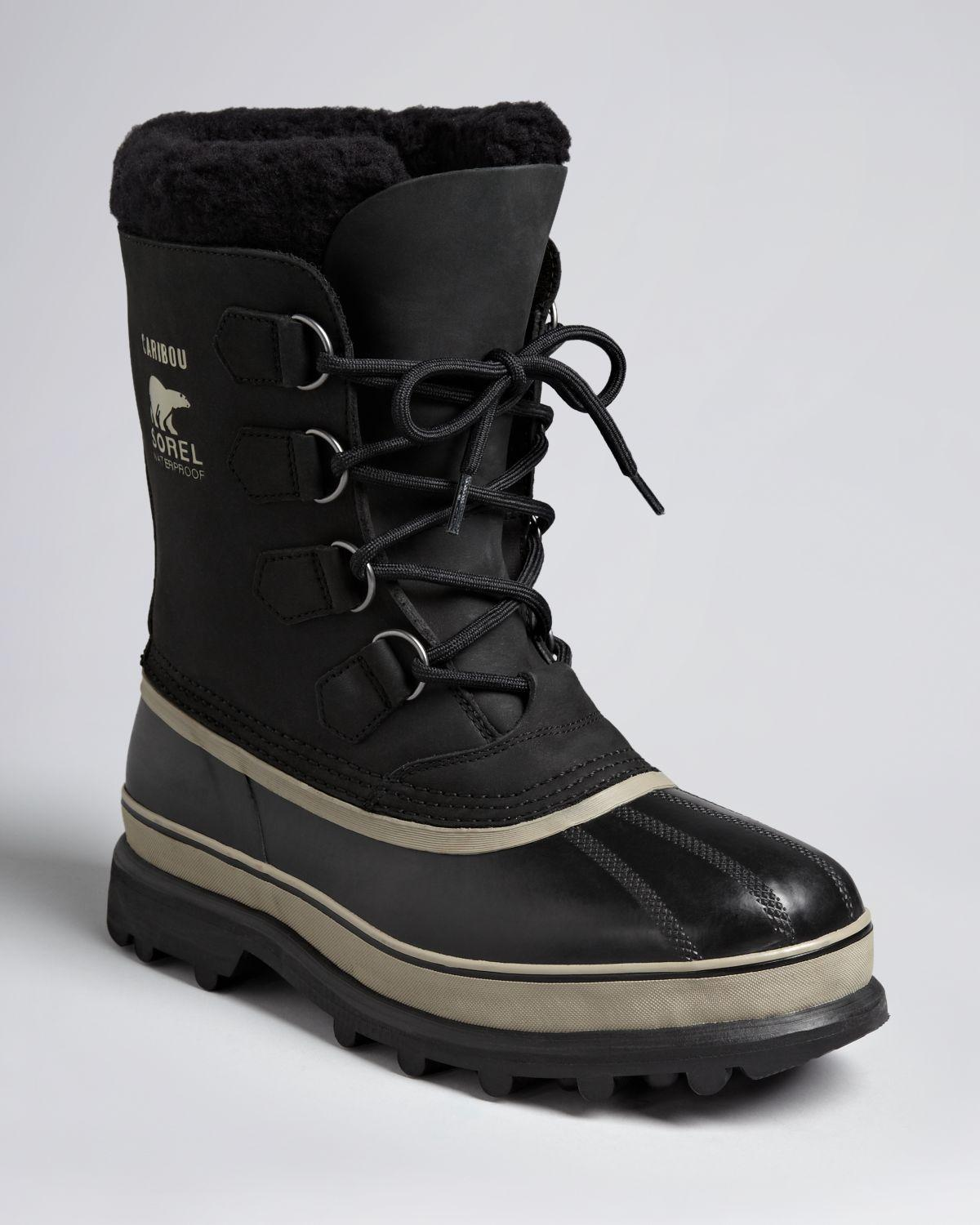 Crafted of black waterproof nubuck and vulcanized rubber, Sorel's Caribou™ snow boots are styled with removable ThermoPlus™ felt liner and Sherpa Pile™ cuff.