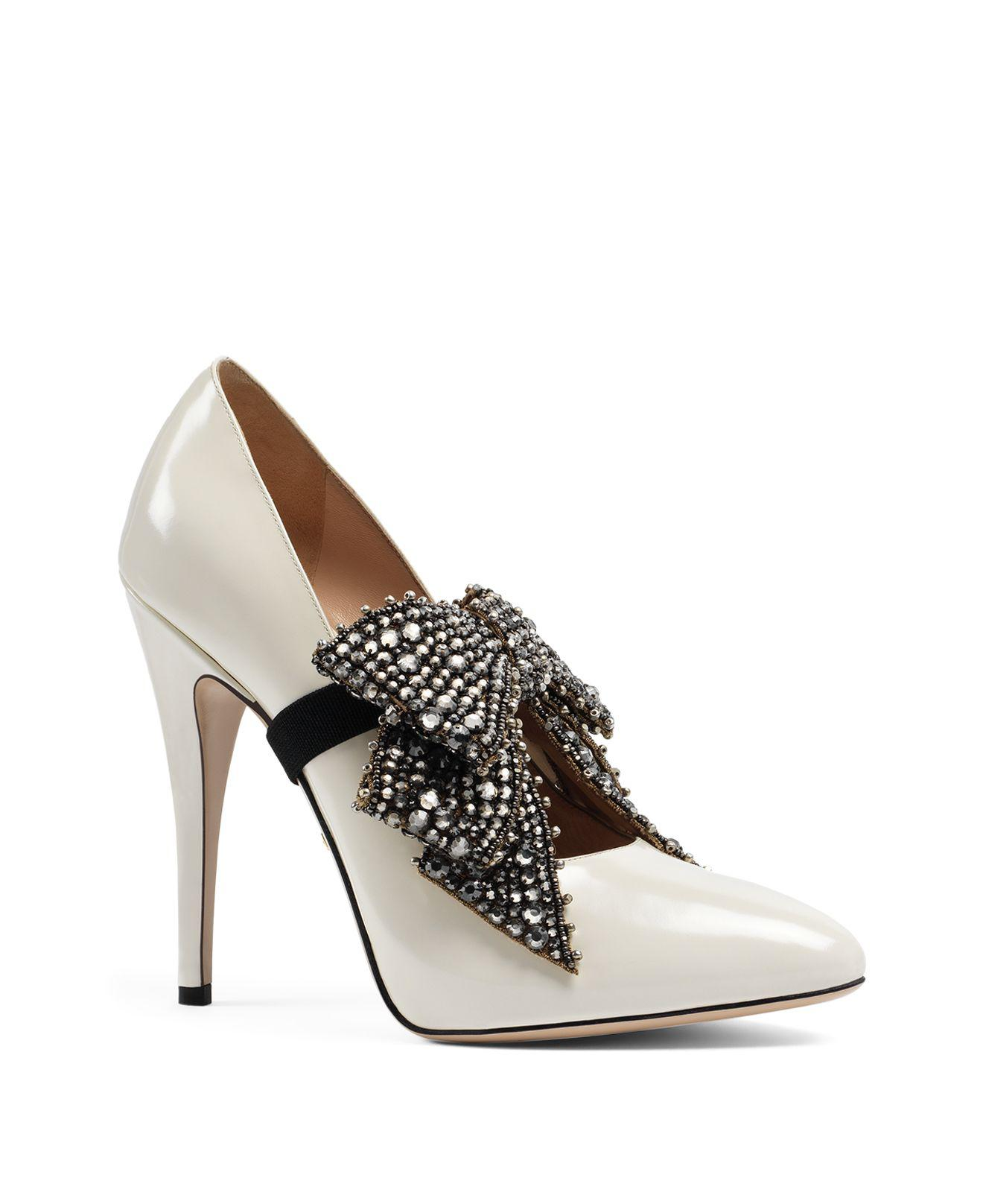 b672b52cd69 Lyst - Gucci Elaisa Embellished Bow Leather Pumps in White