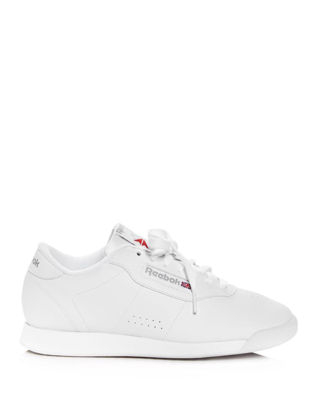 a78deda88449 Lyst - Reebok Women s Princess Faux Leather Lace Up Sneakers in White