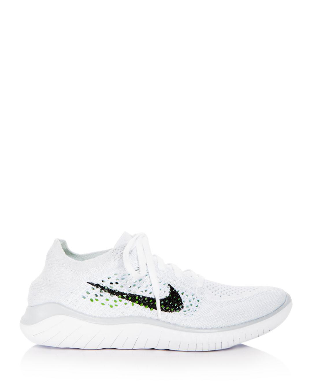 6c2c6873bb62 Lyst - Nike Women s Free Rn Flyknit 2018 Lace Up Sneakers in White - Save  30%