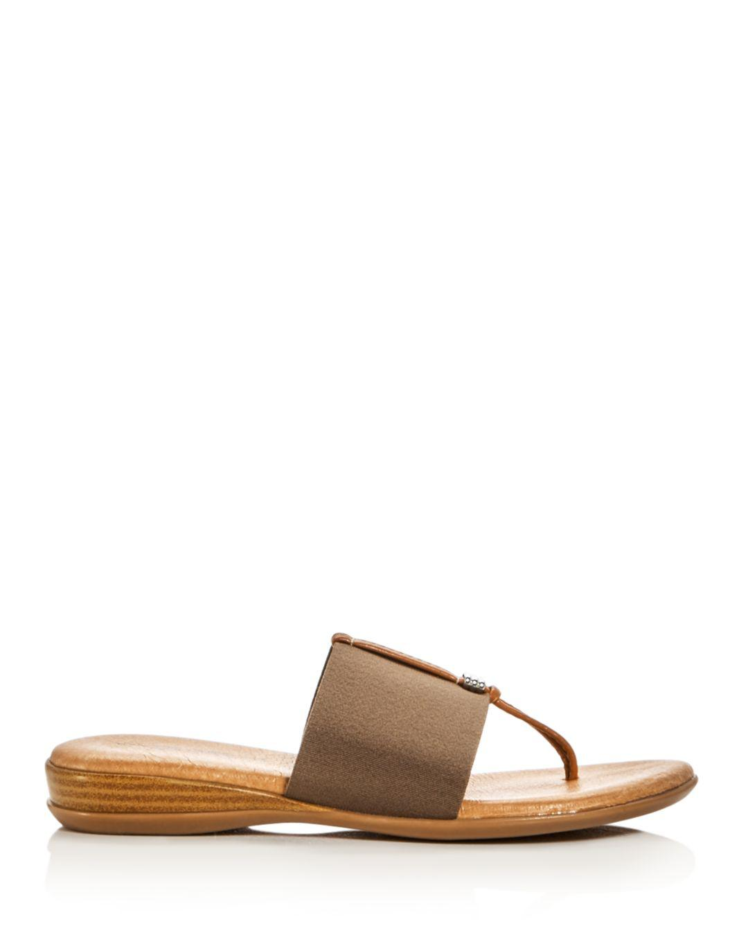d504ab533099 Lyst - Andre Assous Nice Thong Sandals in Brown