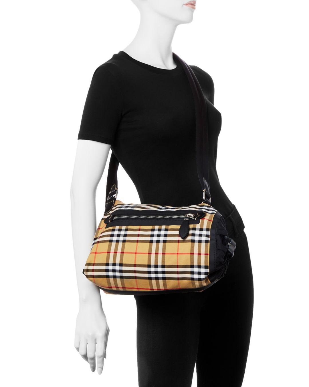 89c134a7f4ad Lyst - Burberry Small Vintage Check Duffel Bag in Black