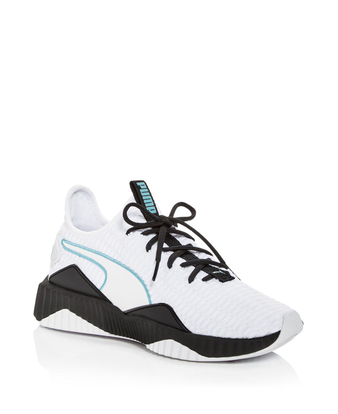 9dc446d96c957f Lyst - Puma Women s Defy Knit Lace Up Sneakers in White for Men