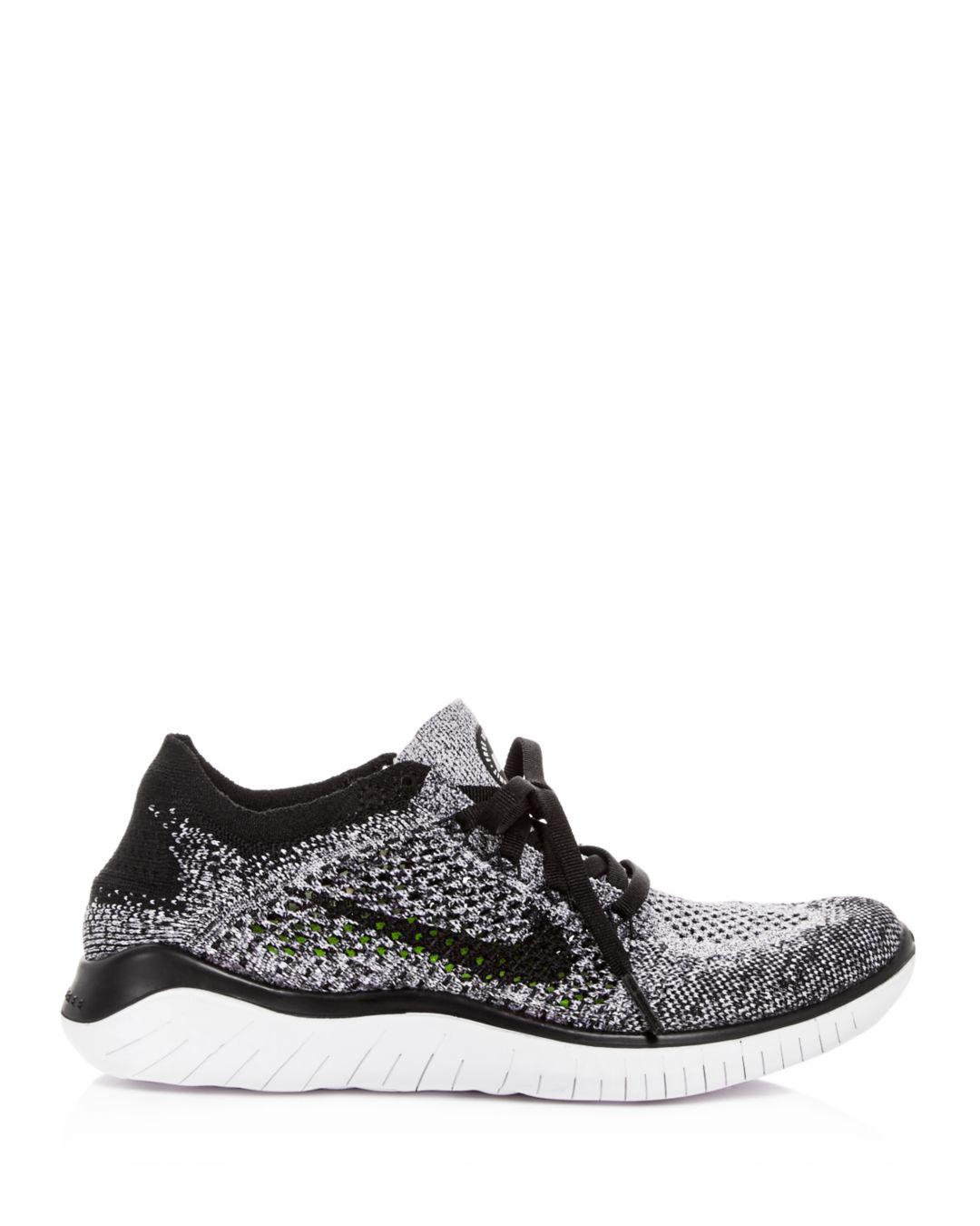 12da24aa9aee Lyst - Nike Women s Free Rn Flyknit 2018 Lace Up Sneakers in Black - Save  25%