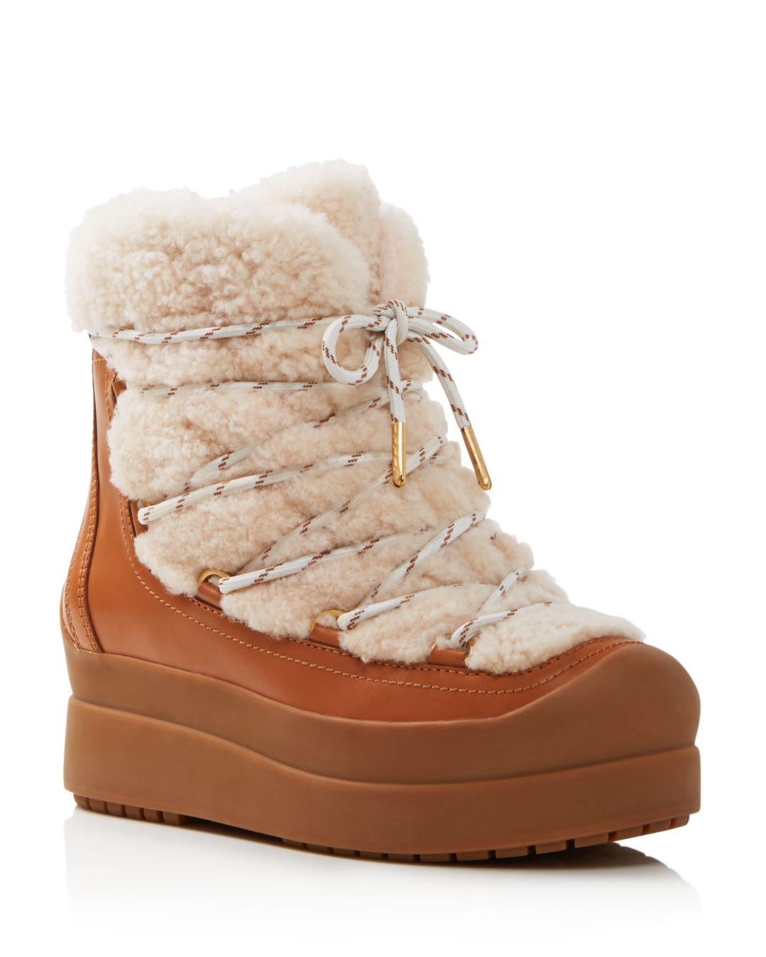 9a7977705ca5 Tory Burch. Natural Women s Courtney Round Toe Leather   Shearling Booties