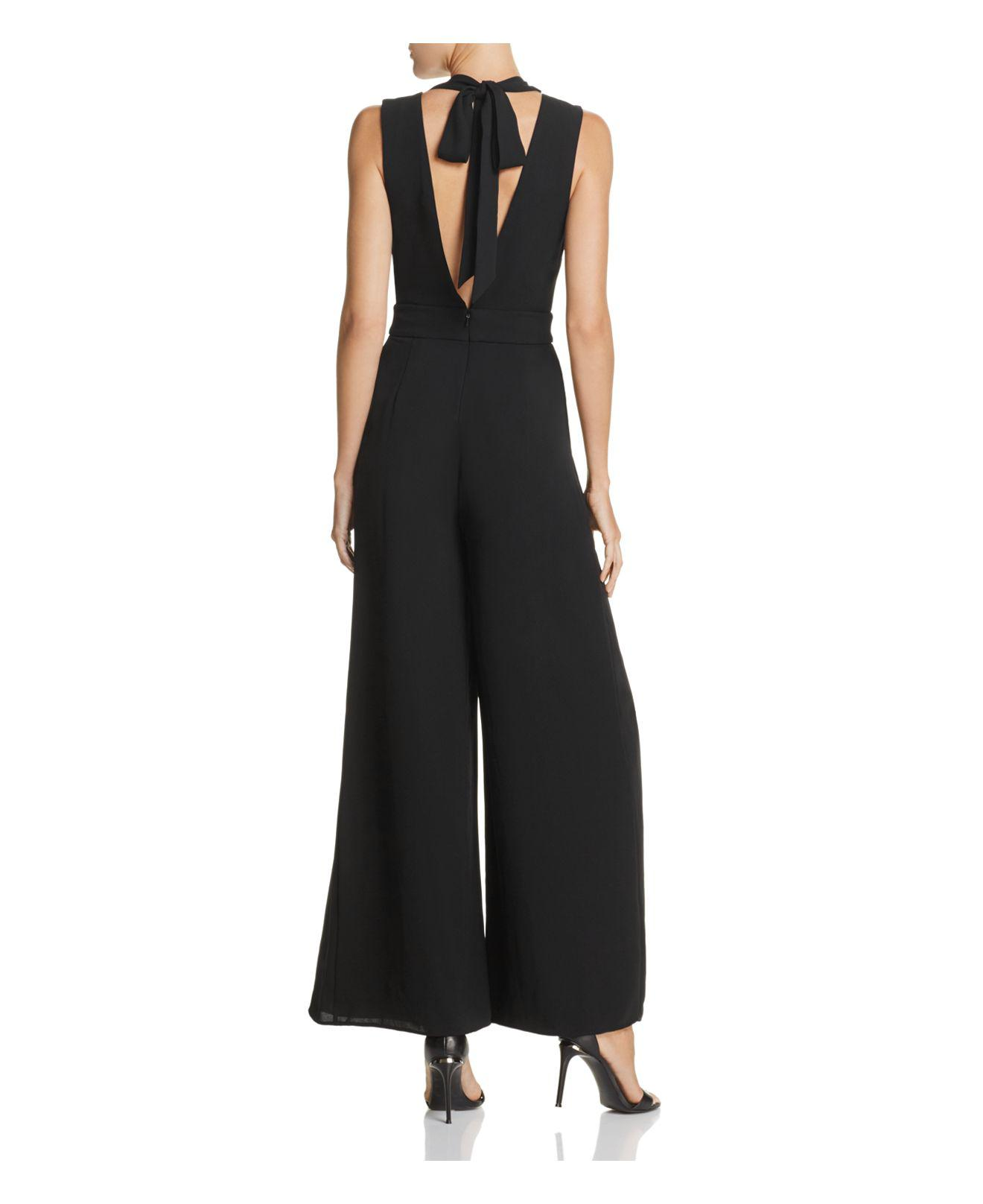 Lyst Fame Partners The Gallus Jumpsuit In Black