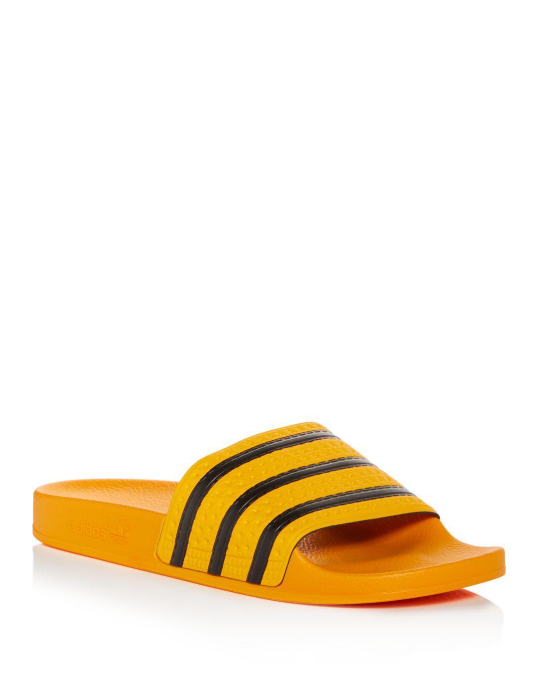 2f2ea21ccfec Lyst - adidas Men s Adilette Slide Sandals in Orange for Men