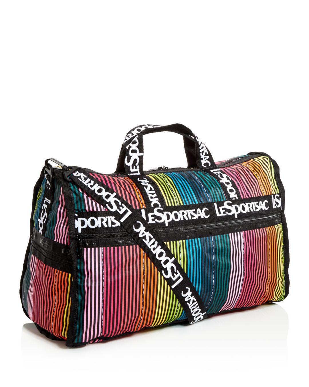 00ef45889ffd Lyst - LeSportsac Candace Weekender Rainbow Stripe Duffel Bag in Black