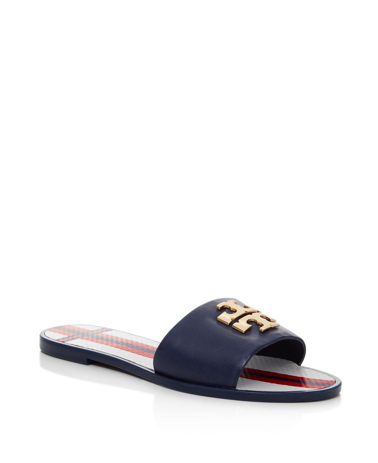 706ac6f03151 Lyst - Tory Burch Logo Jelly Slide Sandal