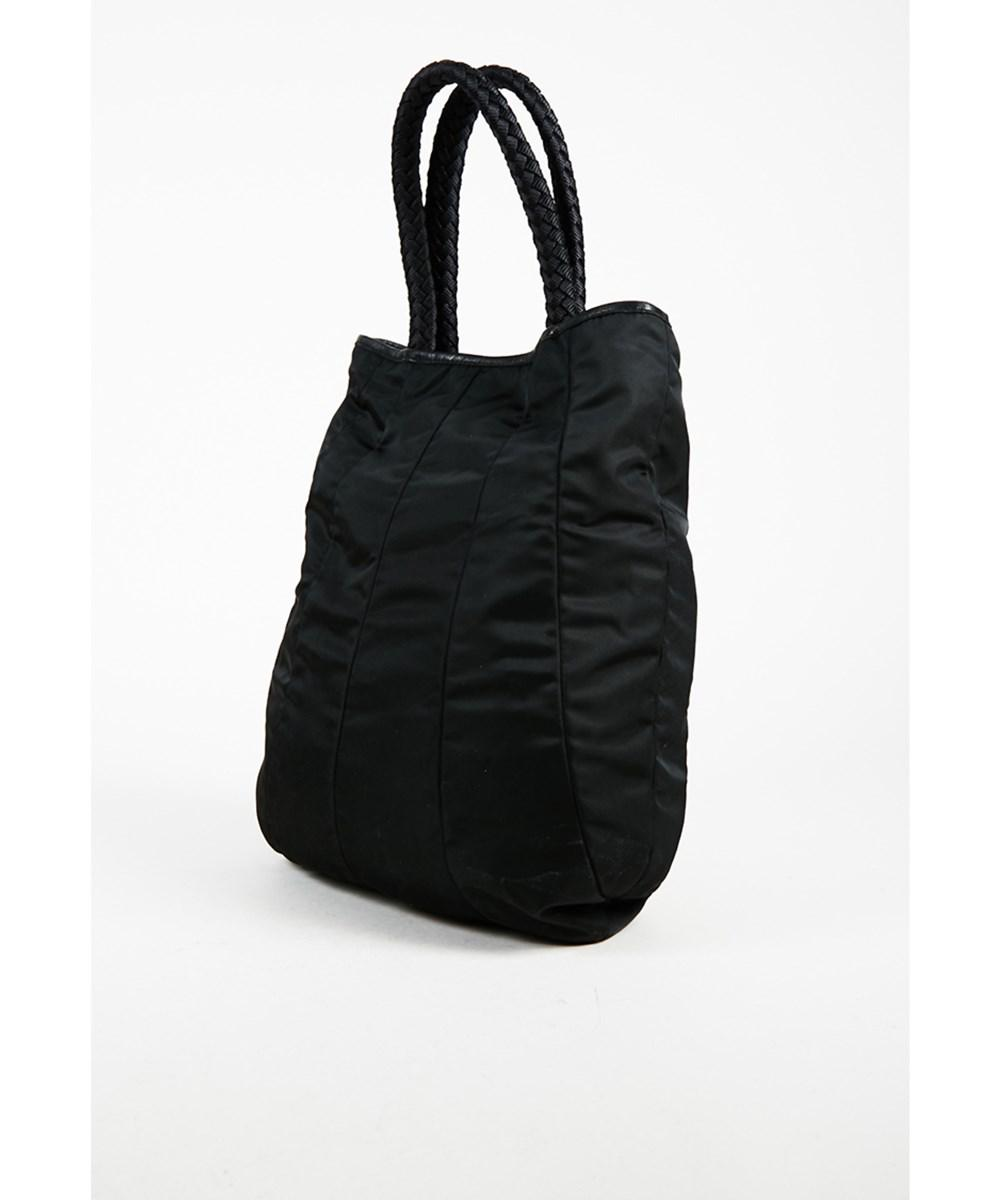 56c3435738 ... promo code for lyst prada 1 black paneled nylon leather trim braided  top handle shoulder bag