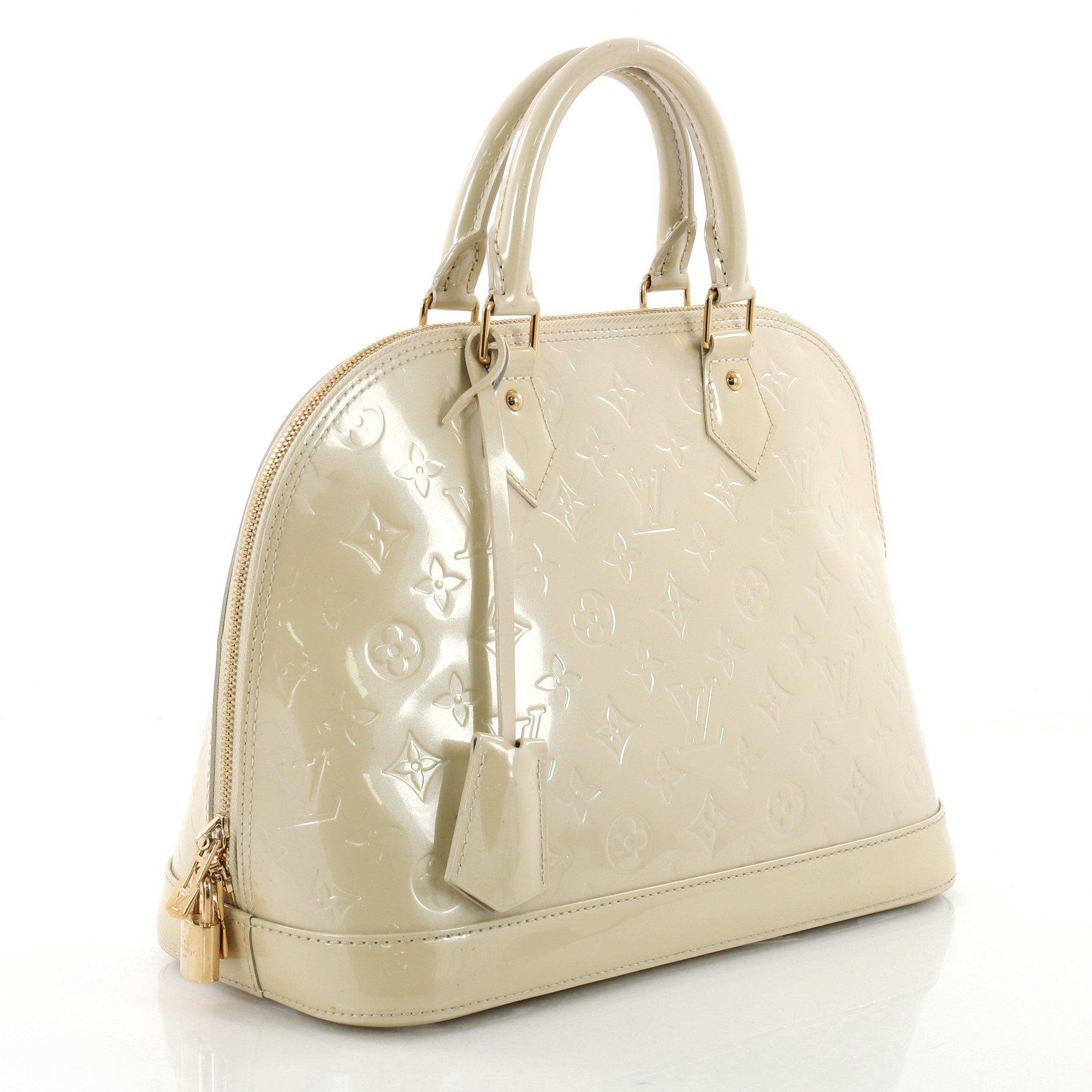ccd2e51d8d9d Lyst - Louis Vuitton Pre Owned Alma Handbag Monogram Vernis Pm in ...
