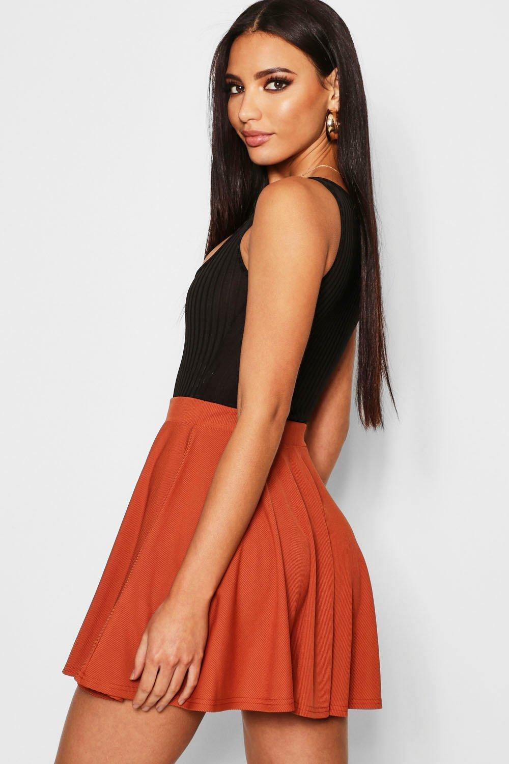 323a24a1313f ... Button Front Ribbed Skater Mini Skirt - Lyst. View fullscreen