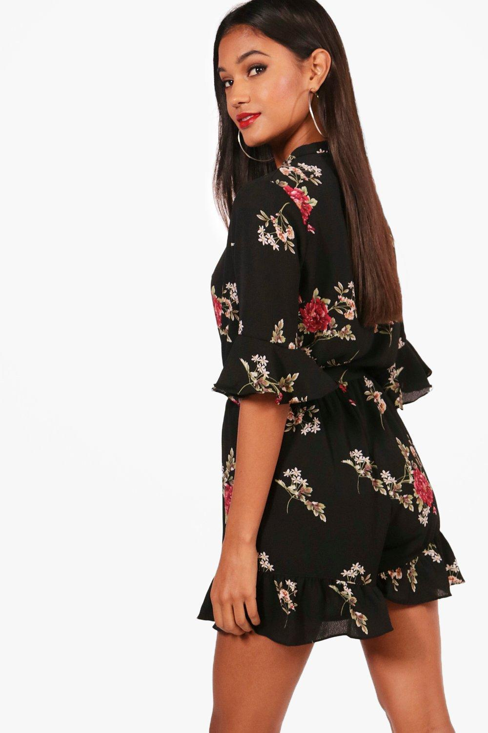 147512664d1 Boohoo - Black Floral Ruffle Sleeve Wrap Over Playsuit - Lyst. View  fullscreen