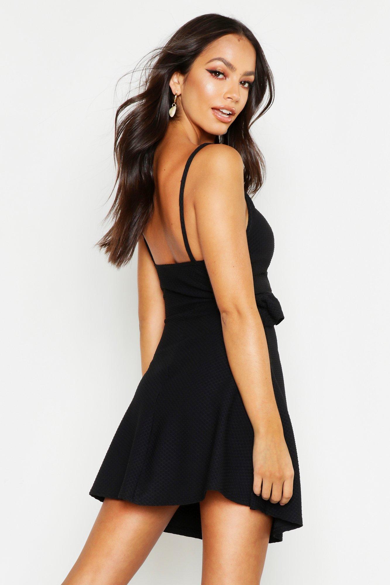 8edab0dd2d65 Boohoo - Black Textured Tie Front Ruffle Skater Dress - Lyst. View  fullscreen