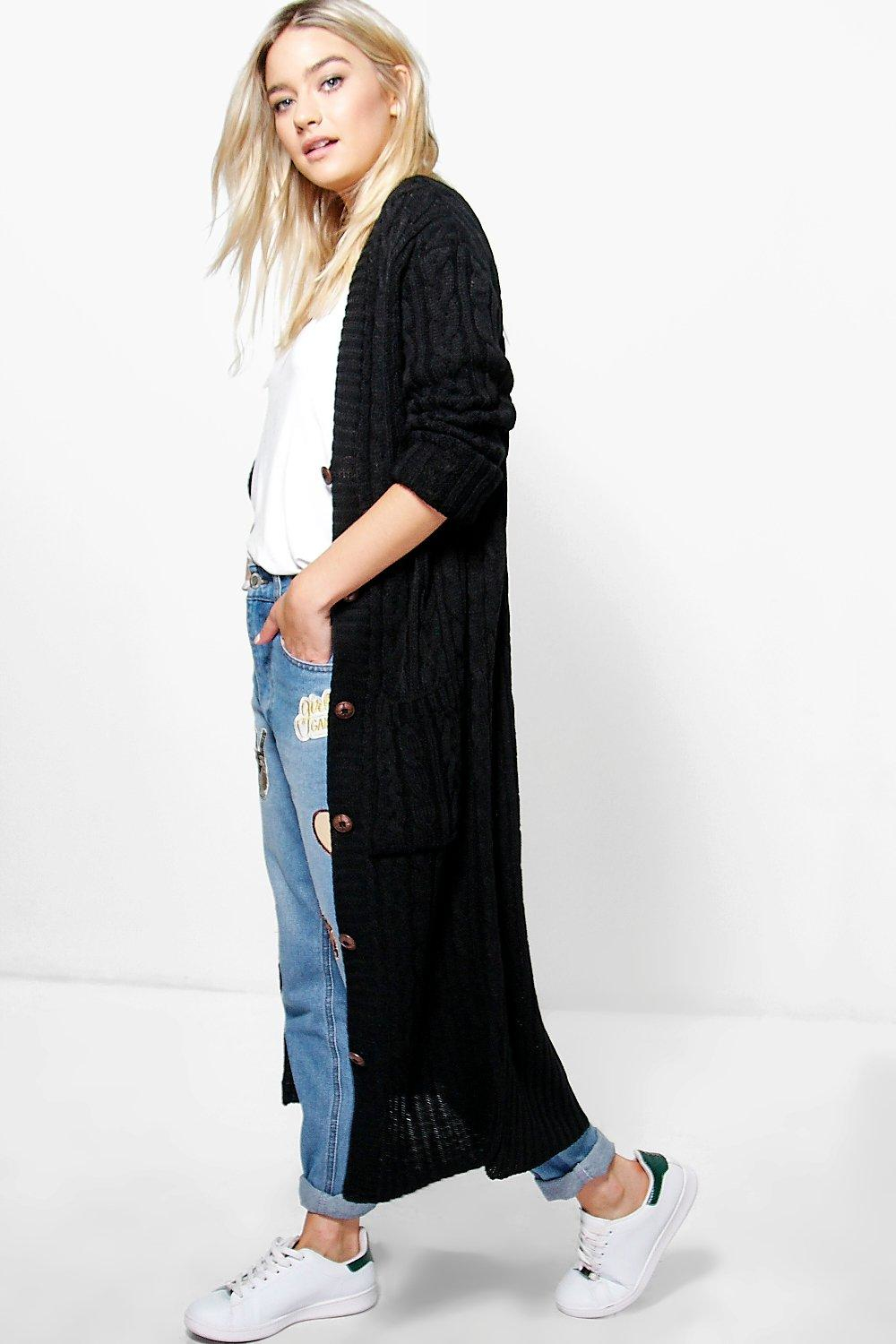 Sheer maxi cardigan made from lightweight chiffon fabric. Great layering piece. Features banded trim and long sleeves. Content & Care % Polyester Machine wash delicate cold, line dry Made in USA Size & Fit Model is wearing size small Measurements taken from.