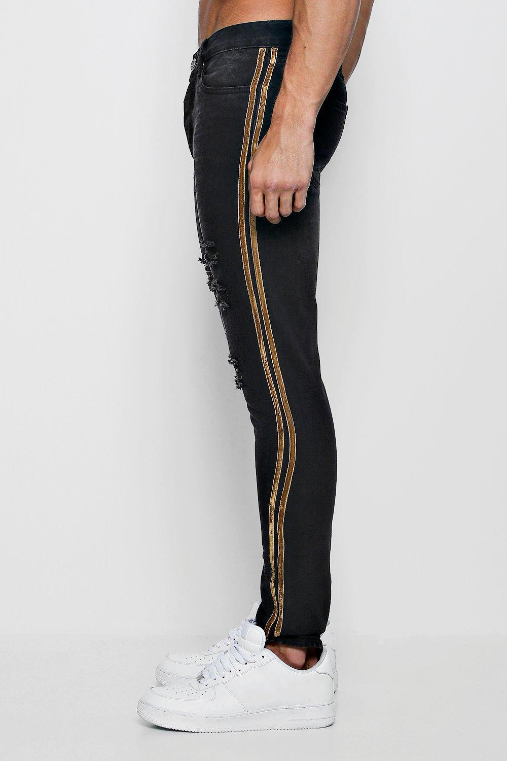 dba7fa0ebf4c4 BoohooMAN - Black Skinny Fit Distressed Jeans With Tape for Men - Lyst.  View fullscreen