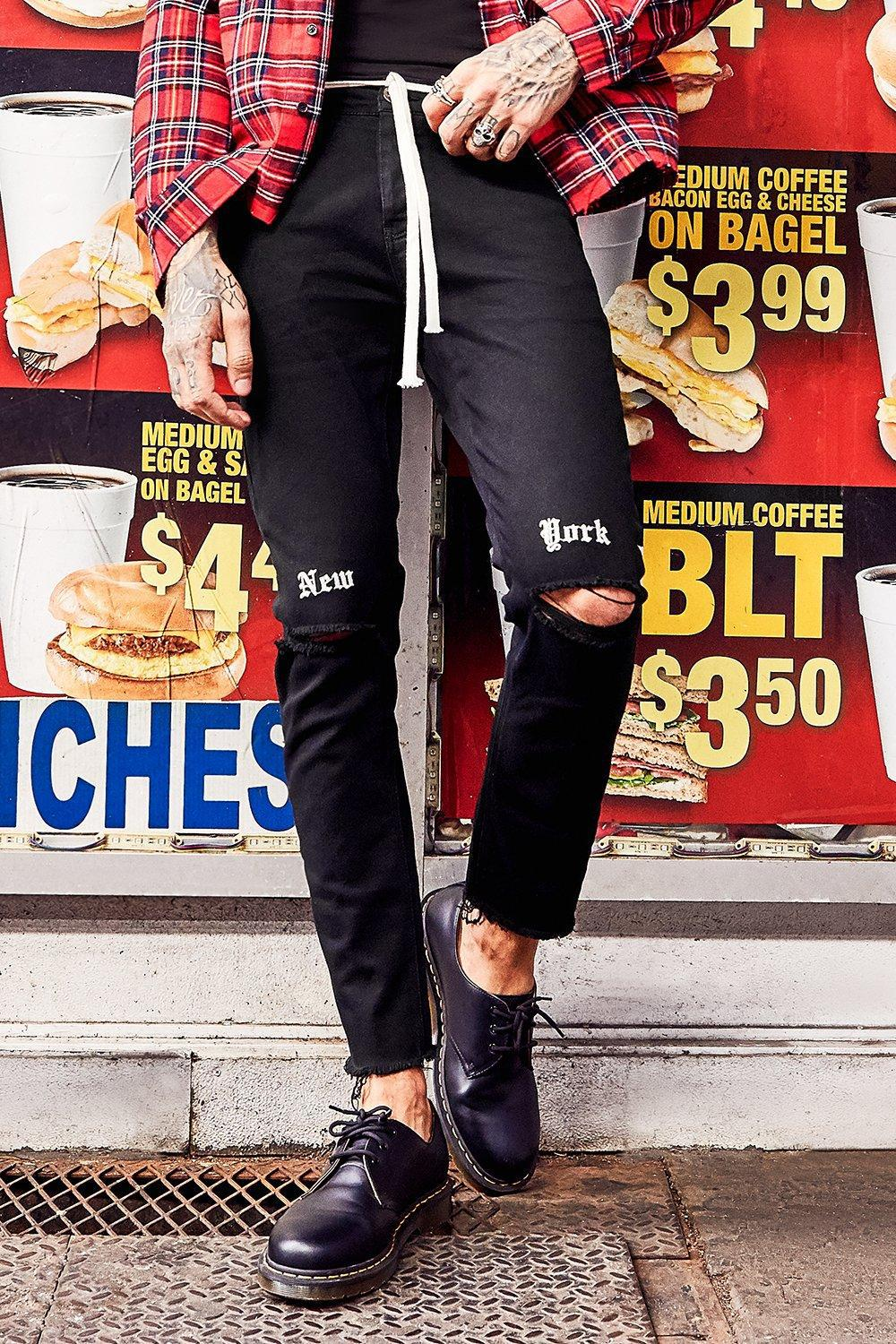 b01294ff40078 BoohooMAN Skinny Fit Distressed Jeans With Ny Embroidery in Black ...