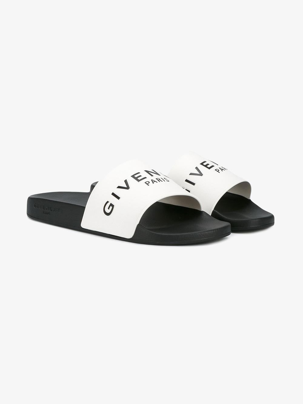 lyst givenchy logo embossed slides in white for men