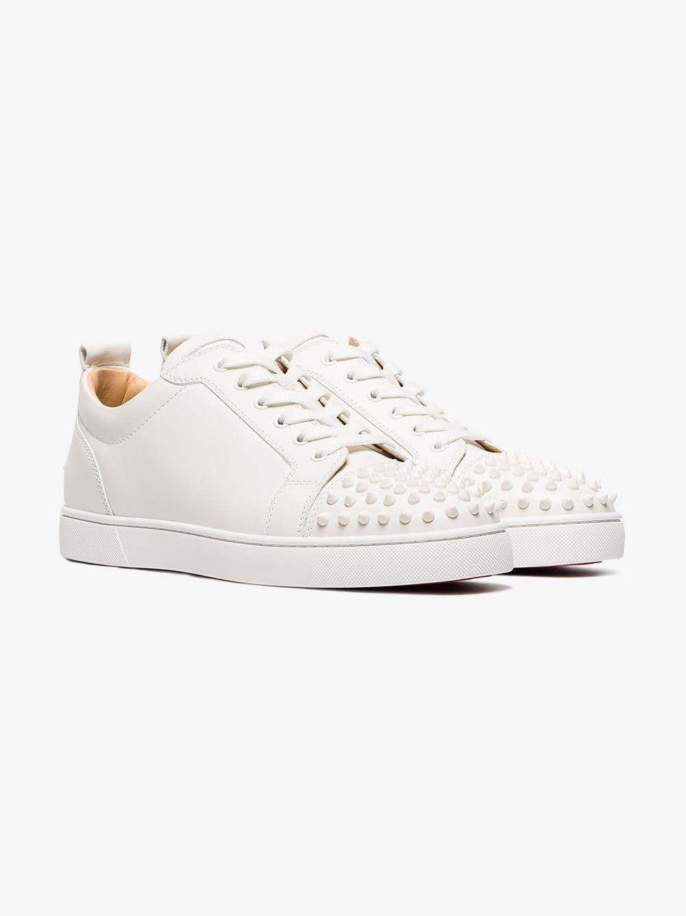 119d792def2c Christian Louboutin. Men s White Louis Junior Studded Leather Sneakers