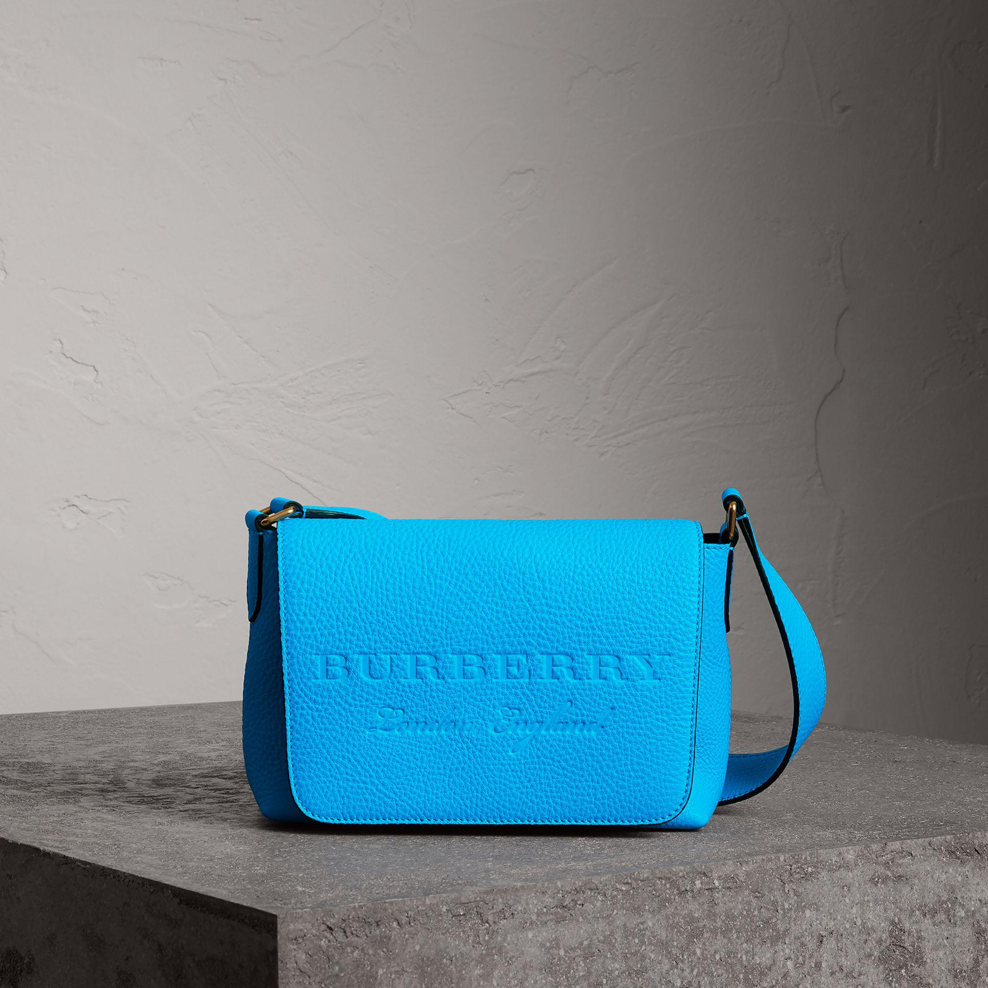 b2650eef4bbb Lyst - Burberry Small Embossed Neon Leather Messenger Bag in Blue