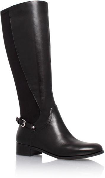 nine west nosymphony low heel knee high boots in black lyst