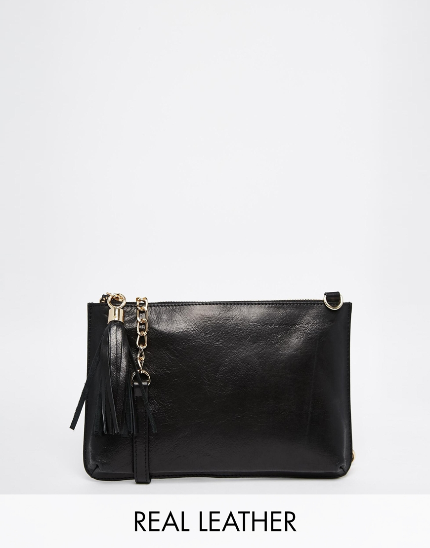 New Look foldover clutch bag in black. $ New Look Clutch Bag. $ True Decadence faux pearl clutch bag. $ Love Moschino Clutch with Faux Fur Strap. ASOS DESIGN structured leather foldover clutch bag. $ ASOS DESIGN clutch bag with ring pearl detail. $ ASOS DESIGN contrast half moon clutch bag. $