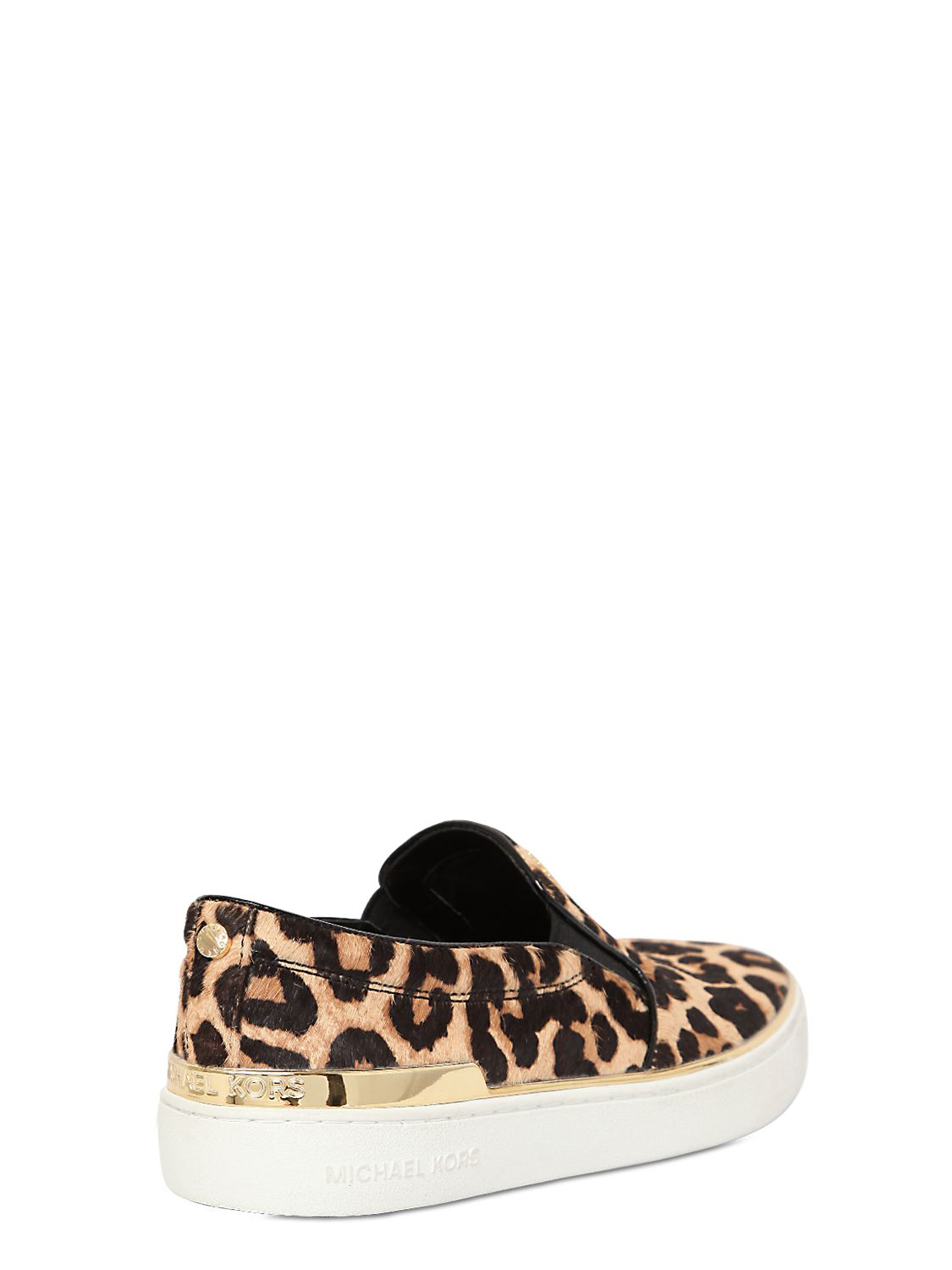 michael michael kors leopard print ponyskin slip on sneakers lyst. Black Bedroom Furniture Sets. Home Design Ideas